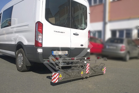 Magnetic broom installed on a tow-bar
