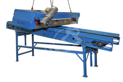 Self-cleaning magnet above conveyor