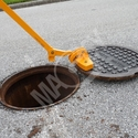 Magnetic manhole lid remover