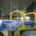 Self-cleaning magnet situated above the conveyor